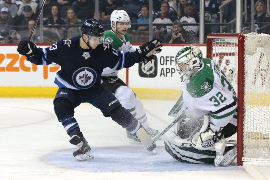 Laine Stars in Victory Over Dallas